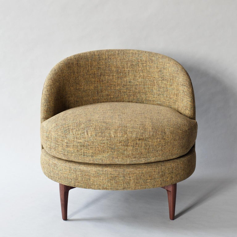 The Belle side chair by DeMuro Das has an elliptical shaped seat and curved back. Solid walnut legs extend up the back of the seat, making this piece interesting from all angles. Construction includes solid hardwood frame with European webbing and