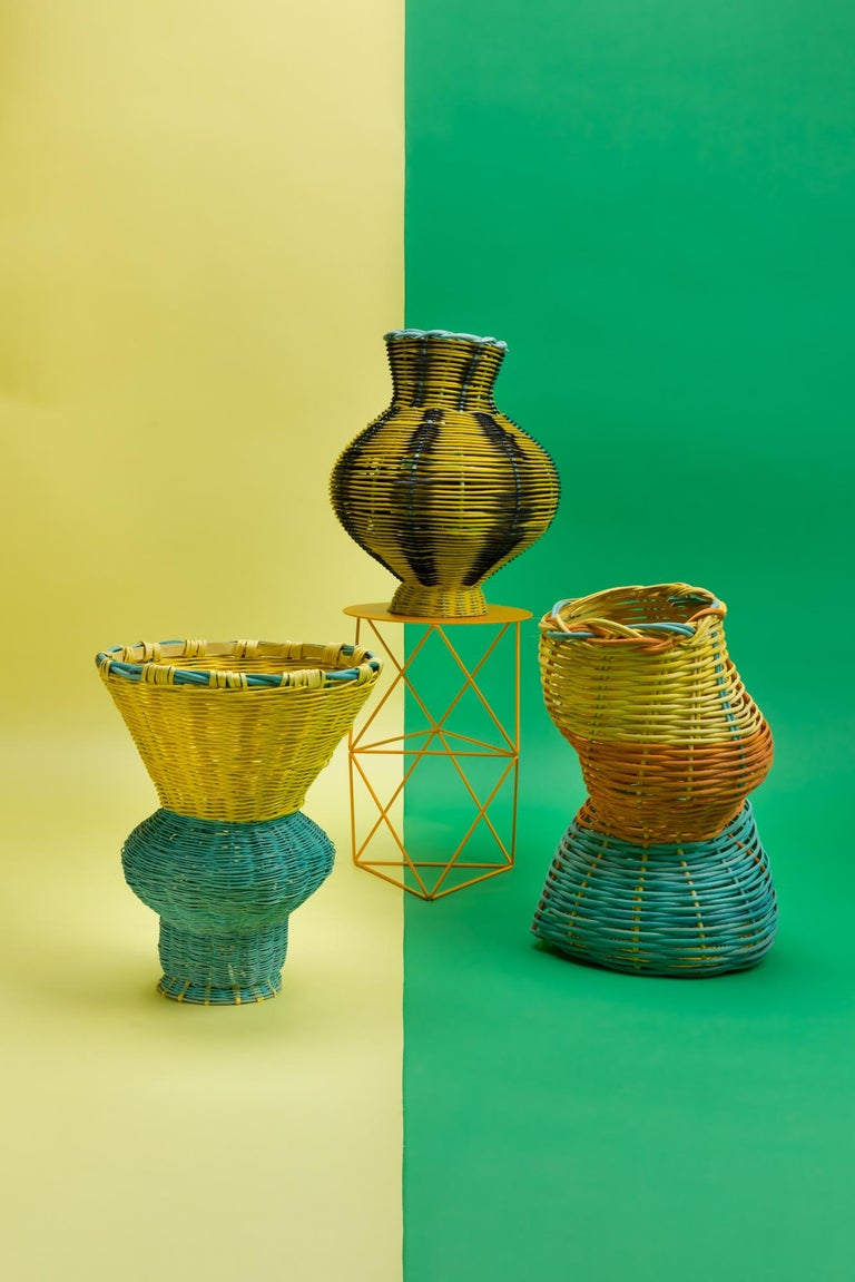 The Belle Vase is hand dyed and woven with reed in our Chicago studio. Inspired by forms in ancient Greek ceramics, the material language of this vessel brings together the rich craft history of weaving with 3 dimensional form.  All of Studio