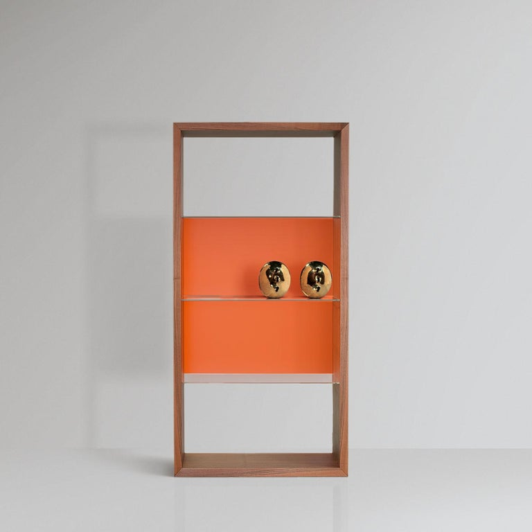 Boasting a symmetrical silhouette with a timeless design, this bookcase is made for displaying bedroom treasures and trinkets. The harmonious combination of empty and full volumes creates a textured decoration for an elegant wall, where natural