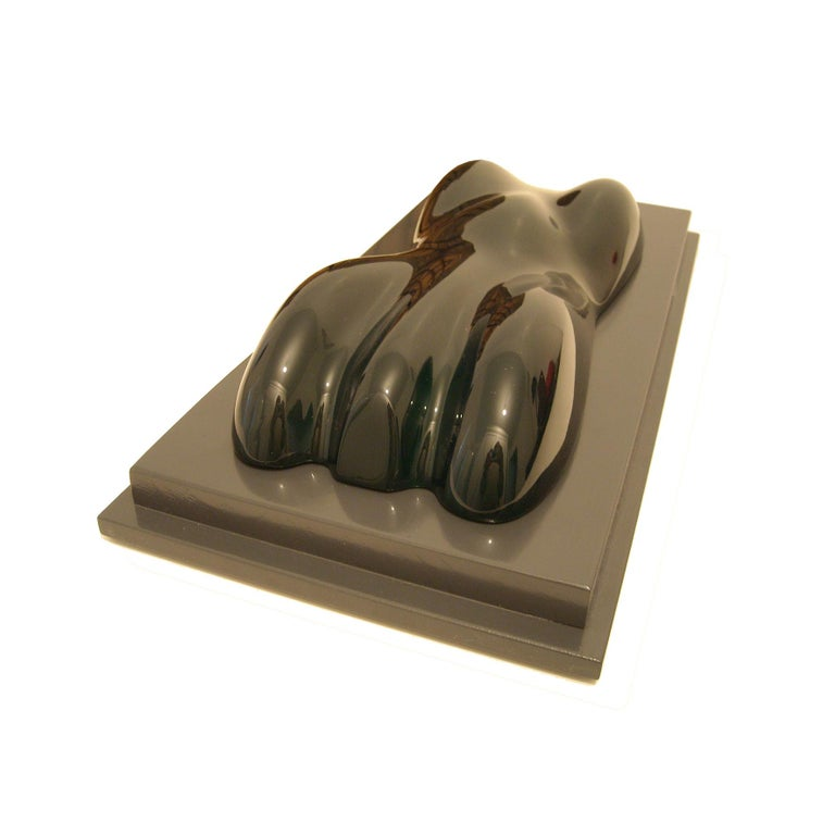 A dark lacquered and varnished plaster model of a racing car. On a lacquered rectangular wood base.  Belzoni finds inspiration in the legendary racing cars of the 1950s and the 1960s. His elegant sculptures epitomize the spirit of a glorious