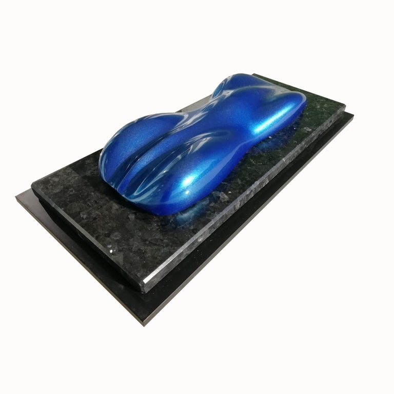A lacquered and varnished plaster model of a racing car.