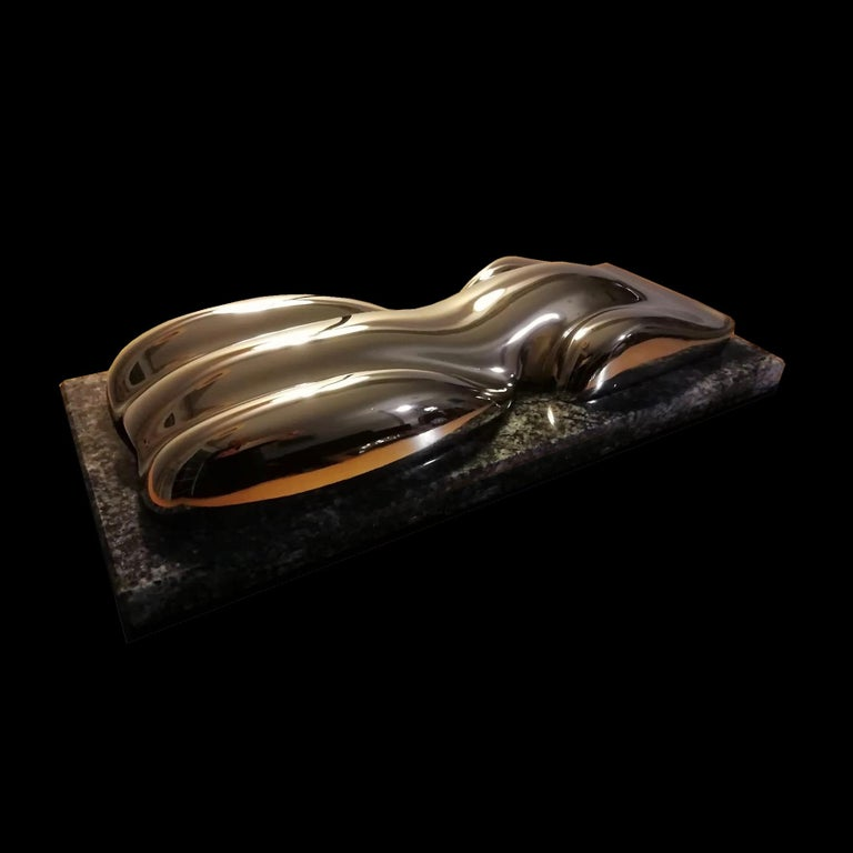 Carmel  A silvered plaster model of a racing car. On a Cheyenne marble or rectangular wood base.  Belzoni finds inspiration in the legendary racing cars of the 1950s and the 1960s. His elegant sculptures epitomize the spirit of a glorious
