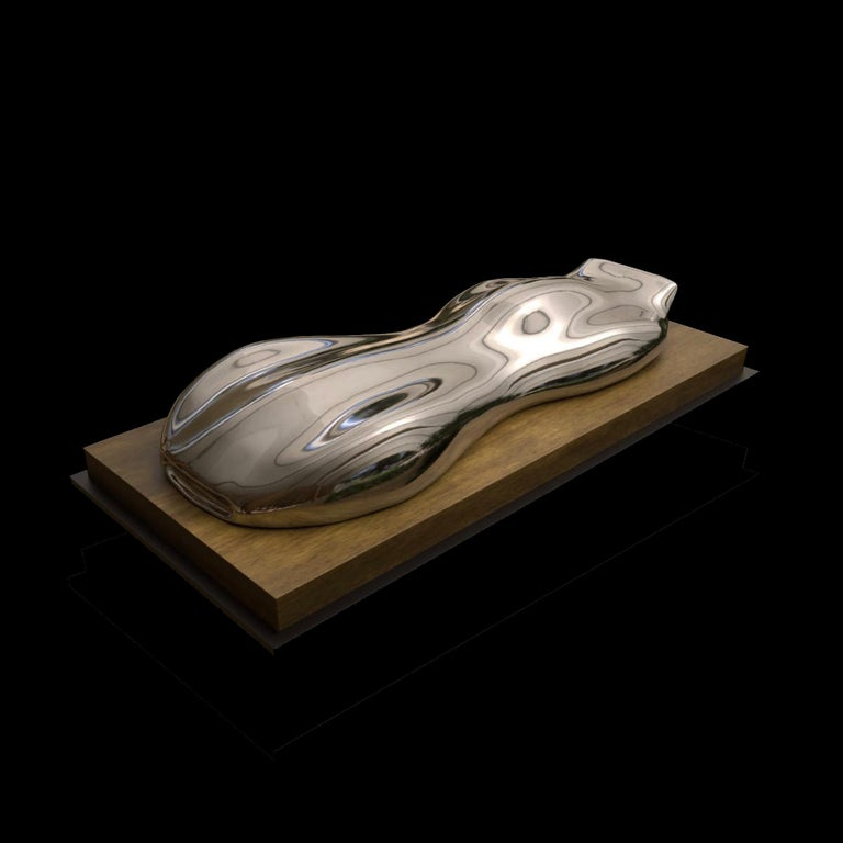Musso  A silvered plaster model of a racing car. On a Cheyenne marble or rectangular wood base.  Belzoni finds inspiration in the legendary racing cars of the 1950s and the 1960s. His elegant sculptures epitomize the spirit of a glorious