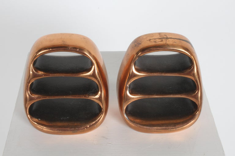 Ben Seibel bookends copper plated finish, designed for Jenfred-Ware and marketed for Raymor. Nice vintage condition, some discoloration and wear to copper finish. Labels on both.