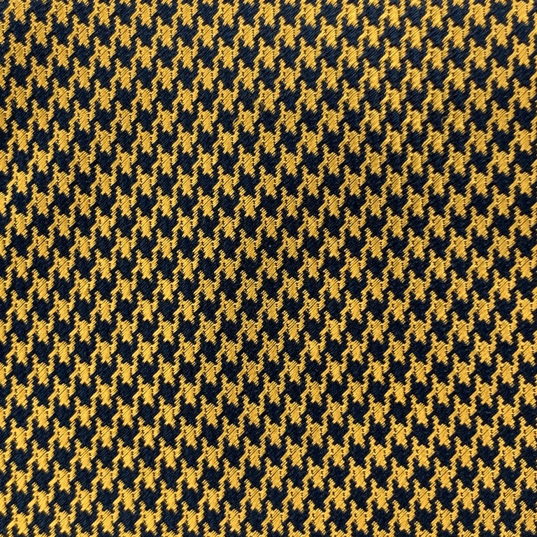 BEN SILVER necktie comes in golden yellow silk with all over navy houndstooth print. Hand made.  Excellent Pre-Owned Condition.  Width: 3.5 in.