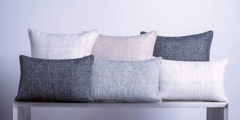 A finely woven nubby texture adds depth to your design. Subtly variegated tones, in a classic palette, add a touch of warmth to any room. Layer with our solid cashmere pillows for contrast. Pillow insert sold separately.