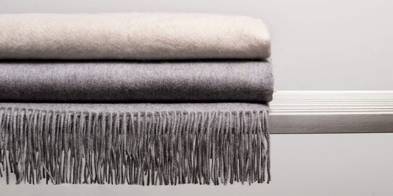 Our interpretation of the classic cashmere throw. We use only the finest 550-gram cashmere yarns, chosen expressly for their extraordinary softness. Soothing neutral tones with twisted fringe-edging make this the perfect finishing touch to your
