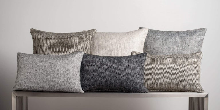 Chevron patterns have been incorporated in design throughout history, a timeless design element that is both modern and classic. Full of textural depth, variegated colors are woven into a subtly graphic design. Layer with our solid cashmere pillows