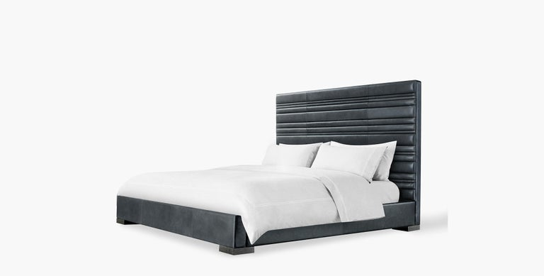 The Fielden bed features layers of tufted channels in varying widths resulting in a handsome textured focal point for your bedroom. Size: King. Upholstered with refined saddle slate leather.