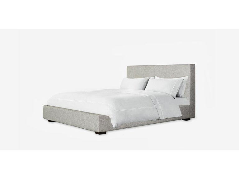 The richly upholstered Loma bed offers a low profile silhouette for your bedroom, with clean linear lines offering a minimal, elegant vignette. Size: California King. Upholstered with performance refined heather fabric.