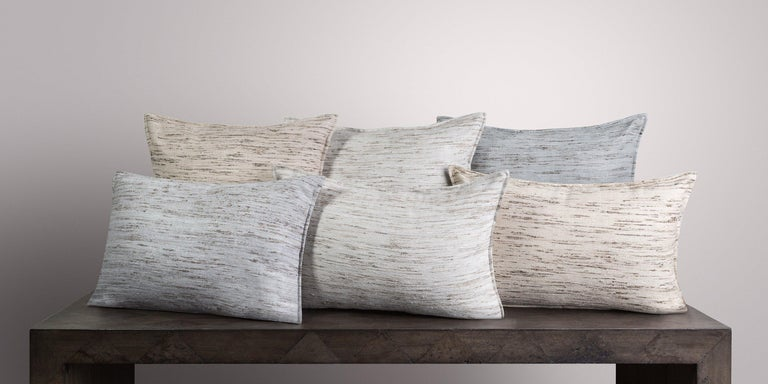 The 100% handwoven real silk pillow offers an all over subtle texture combined with soft luxurious touch. Offered in our signature neutral palette make them the perfect accent to your space. Pillow insert sold separately.  Size 26