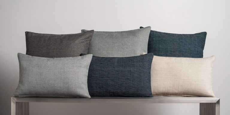 A finely woven nubby texture adds depth to your design. Subtly variegated tones, in a classic palette, add a touch of warmth to any room. Layer with our solid cashmere pillows for contrast. Pillow insert sold separately.  Size 22
