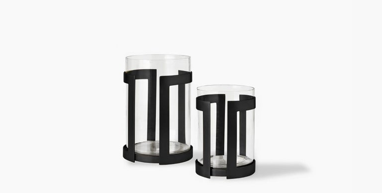 Our Thorne Hurricane Candle Holder brilliantly showcases the glow of pillar candles in its minimal metal frame paired with a glass insert. Our handcrafted finishes are inspired by variations within natural textures. Each selection is slightly