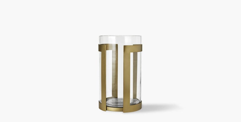Our Thorne Brass Hurricane Candle Holder brilliantly showcases the glow of pillar candles in its minimal brass frame paired with a glass insert. Our handcrafted finishes are inspired by variations within natural textures. Each selection is slightly