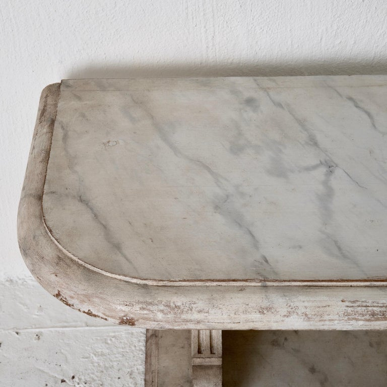 Bench console Swedish 18th century faux marble paint, Sweden. A bench made during the 18th century in Sweden. Painted later in a faux marble pattern. Rectangular shape with rounded corners. Channeled details on sides.