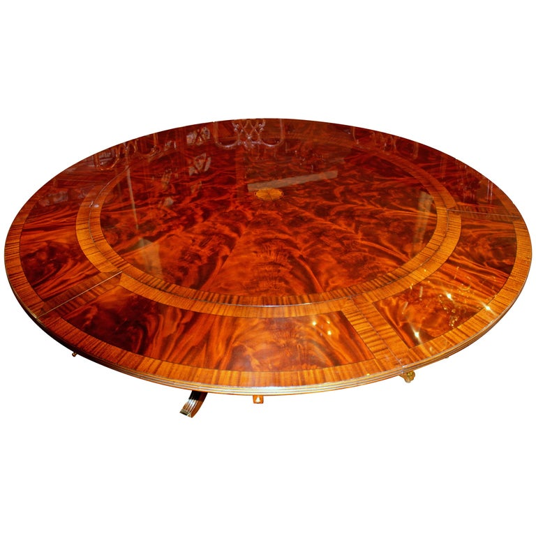 Benchmade Bookmatched Flame Mahogany Perimeter Leaf Circular Dining Table For
