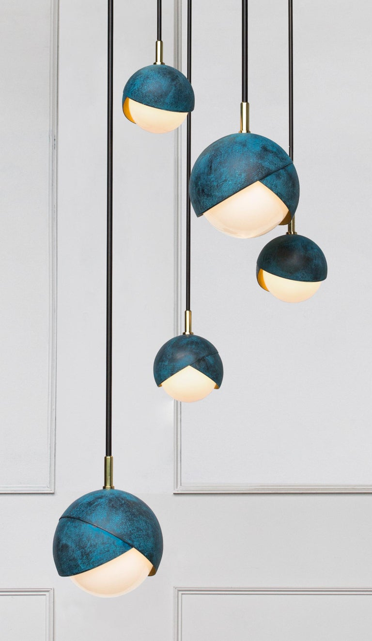 The Benedict Cluster is a fully customizable dynamic arrangement of any number of our Benedict Series Pendants.  Given the made-to-order flexibility, each arrangement can be tailored to fit the needs of any space in your project.  Whether it's a