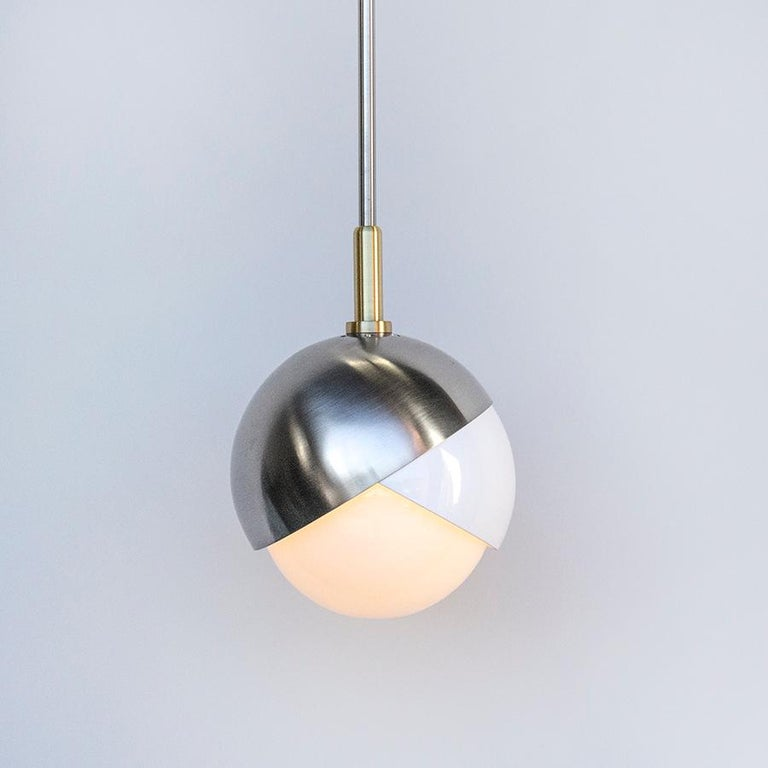 Blackened Benedict Wall Sconce in a Satin Brass Finish with White Opal Glass For Sale