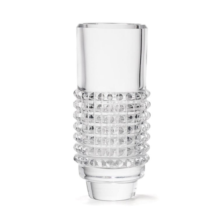 A fine and stylish vintage Swedish art glass Corona 3 vase designed by Bengt Edenfalk for Skruf Glasbruk. The tall cylindrical shaped crystal glass vase has a diamond cut design around the lower body with a slice cut top rim and narrow rounded foot.