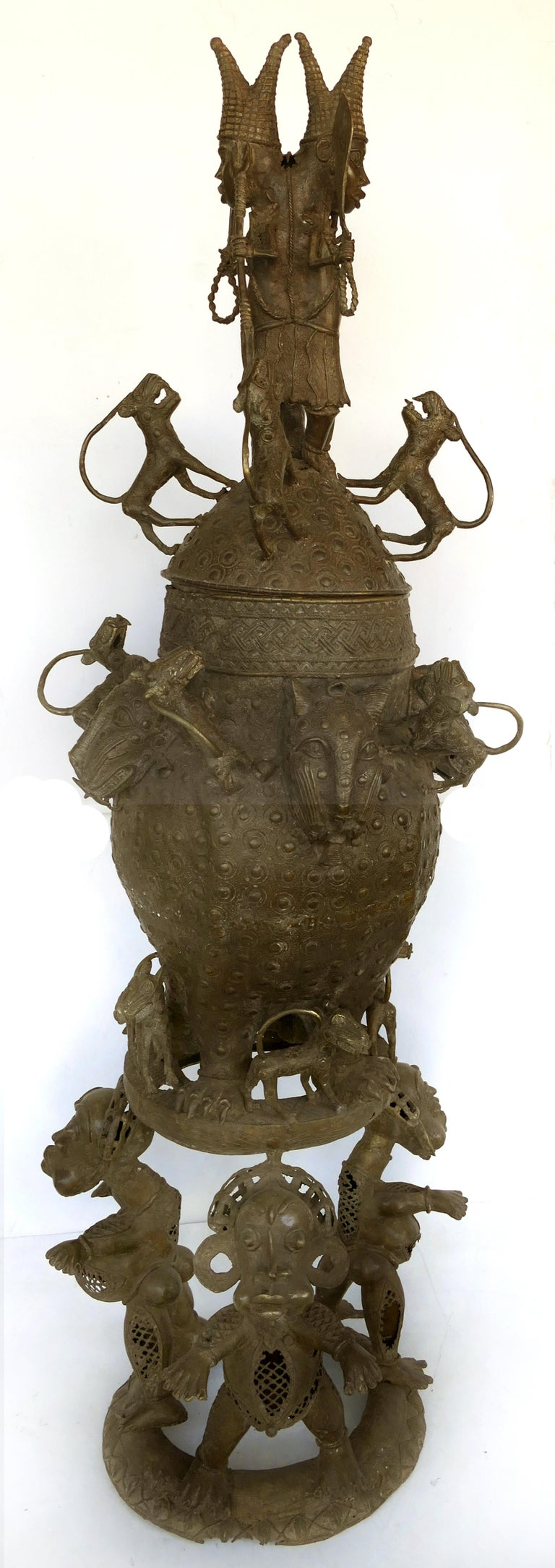 Mid-20th century Benin (Nigeria)bronze figural offering depicting leopards and tribesmen    Offered for sale is a modern-day Benin (Nigeria) bronze figural offering depicting leopards and tribesmen. The modern-day Nigerian people have created