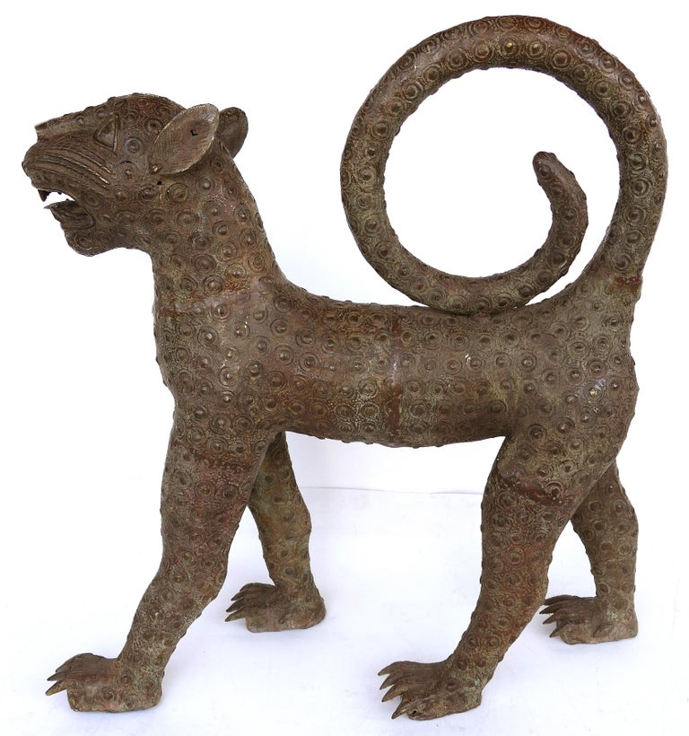 Benin (Nigeria) bronze sculptures of leopards from the mid-20th century  Offered for sale is a pair of modern mid-20th century copies of Benin (modern-day Nigeria) bronze figural sculptures of leopards. This large and impressive pair of leopards