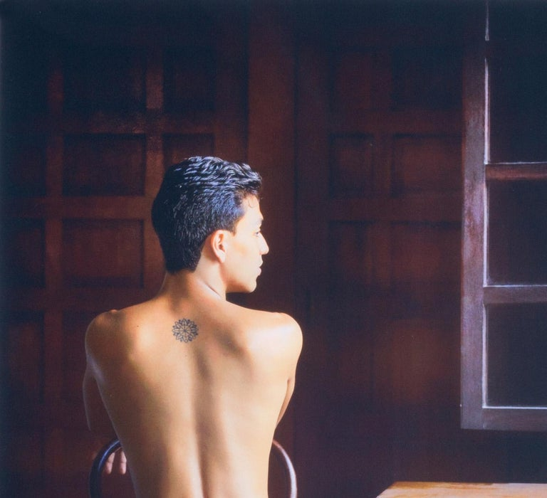Looking Out (nude male Bel Ami model in Colombia seated in old colonial house) - Photograph by Benno Thoma