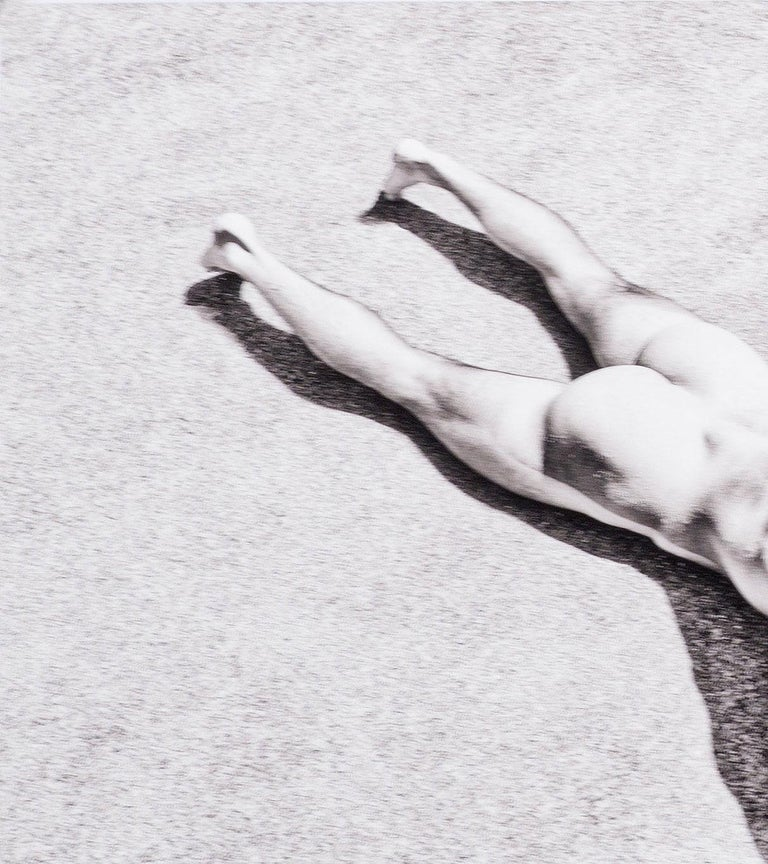 Rocks (nude model from Bel Ami lies prone with rocks in Greece) - Photograph by Benno Thoma