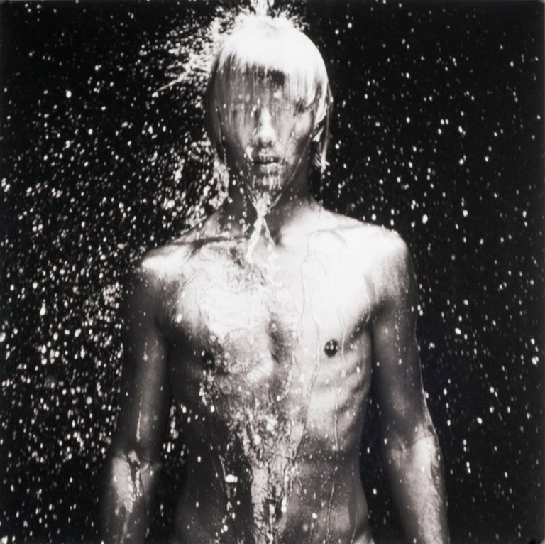 Benno Thoma Black and White Photograph - WET 11 (young nude Dutch boy being doused by droplets of water)