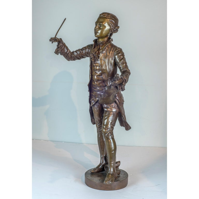 A Fine Patinated Bronze Statue of a Musician Holding a Violin by B.L. HERCULE - Sculpture by Benoit Lucien Hercule