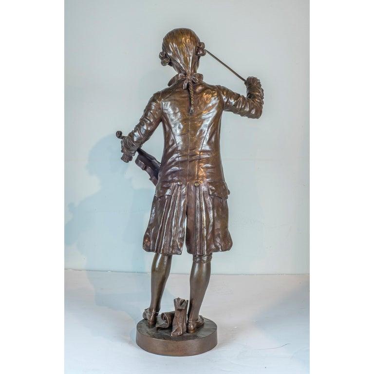 A Fine Patinated Bronze Statue of a Musician Holding a Violin by B.L. HERCULE - Gold Figurative Sculpture by Benoit Lucien Hercule