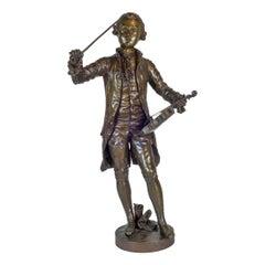 A Fine Patinated Bronze Statue of a Musician Holding a Violin by B.L. HERCULE
