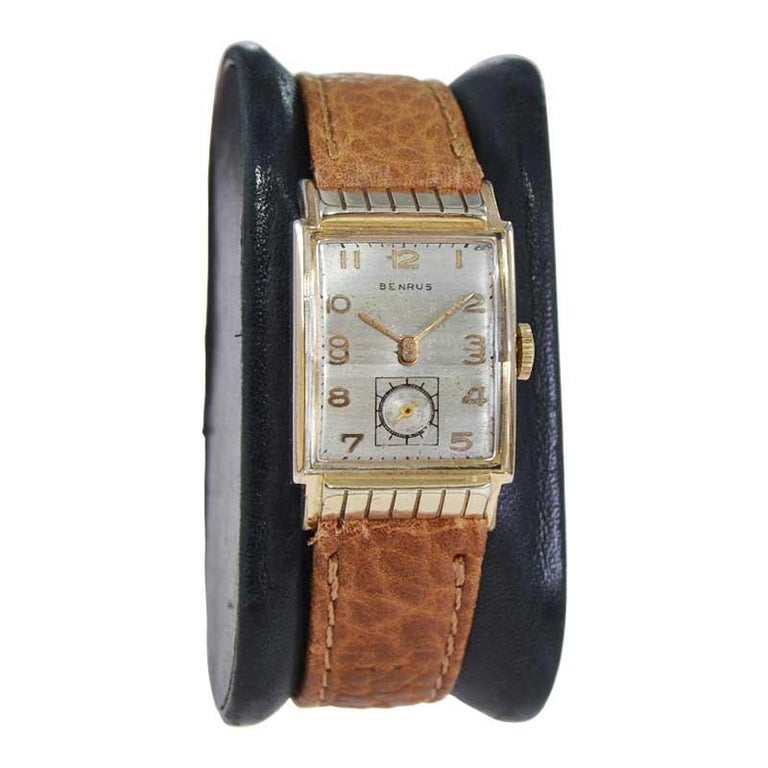 FACTORY / HOUSE: Benrus Watch Company STYLE / REFERENCE: Art Deco Tank Style METAL / MATERIAL: Yellow Gold Filled  CIRCA / YEAR: 1940's DIMENSIONS / SIZE: 34mm x 21mm MOVEMENT / CALIBER: Manual Winding / 17 Jewels  DIAL / HANDS: Original Silvered