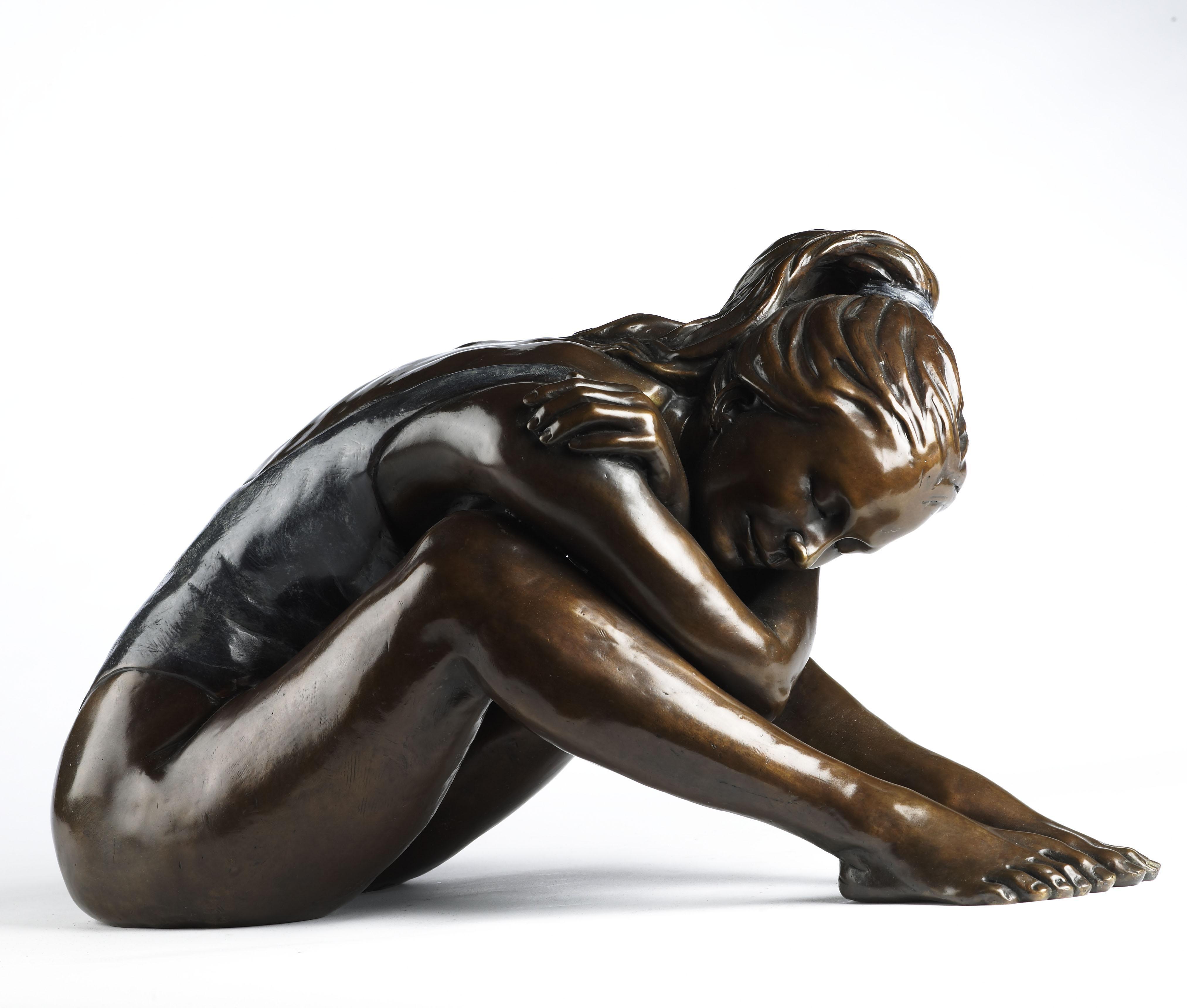 Olympiad. A bronze sculpture of a resting ballet dancer figure by Benson Landes