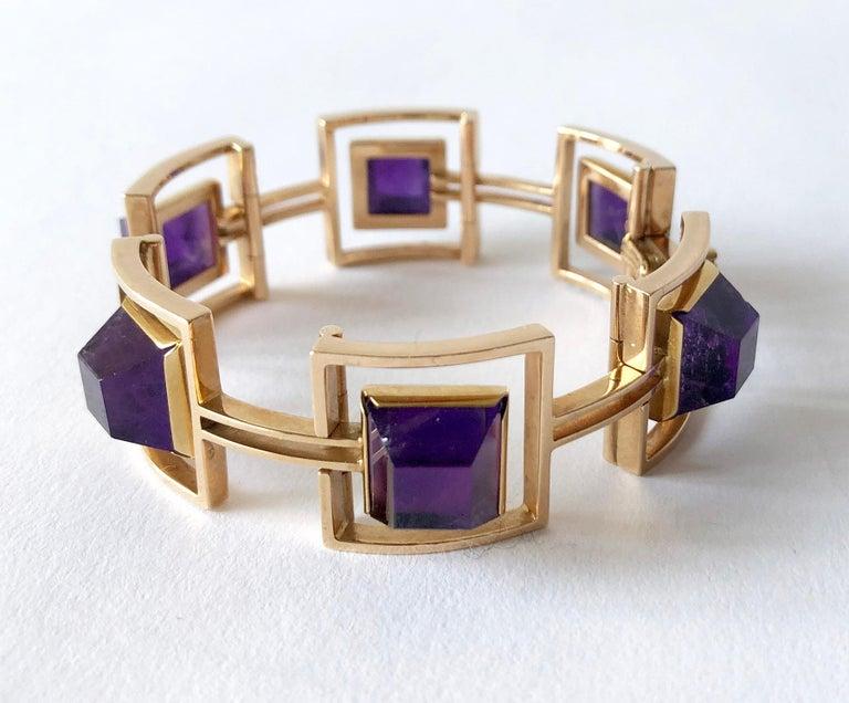 Danish modern 14k gold linked bracelet with six square, high domed amethyst stones created by Bent Knudsen of Denmark.  Bracelet measures 6.5
