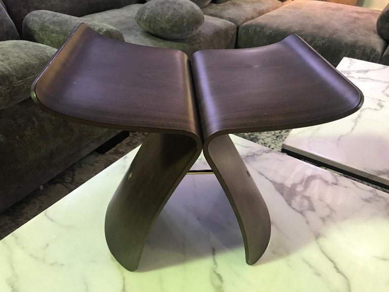A perfect fusion of western function and eastern/ Asian sensibility, the iconic butterfly stool was originally conceived in 1954 by Japanese designer Sori Yanagi. The stool is made from two curving and inverted L-shaped rosewood sections, each