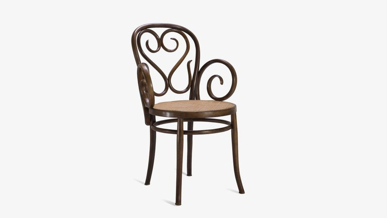 An exquisite example of fine Italian craftsmanship very much in the style of Thonet. These chairs feature intricate woodwork that is wonderfully visually seductive. Generous swooping arms are the staple of this particular design which frame a round