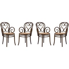 Bentwood Dining Armchairs with Caned Seats by Salvatore Leone, Set of Four