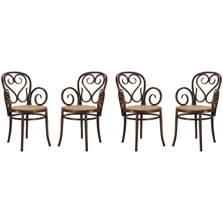Bentwood Dining Armchairs with Caned Seats by Salvatore Leone, Set of Four For Sale