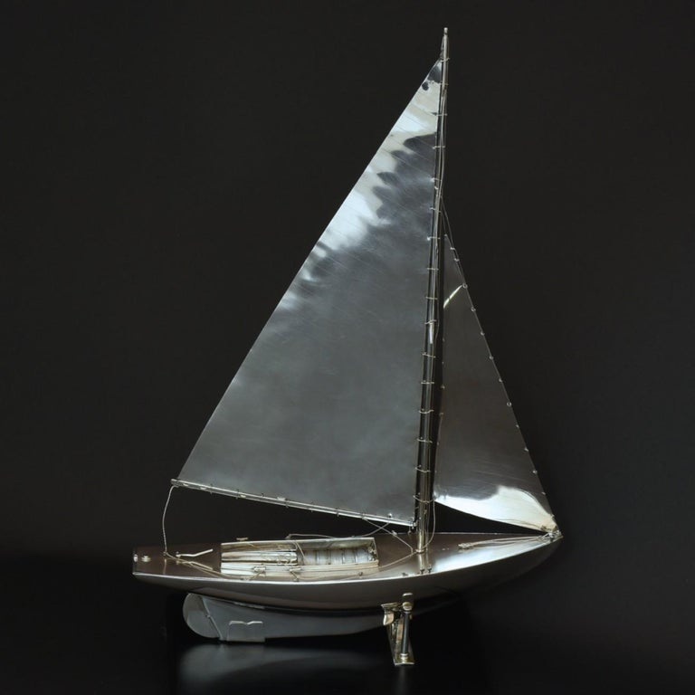 An exceptional scale model of a Mylne O.D. class yacht made in sterling silver, hall marked 1935. Beautifully detailed, it even has sterling silver rigging and sails!  Benzie of Cowes was established in 1862 by the late Mr. Simpson Benzie. Through