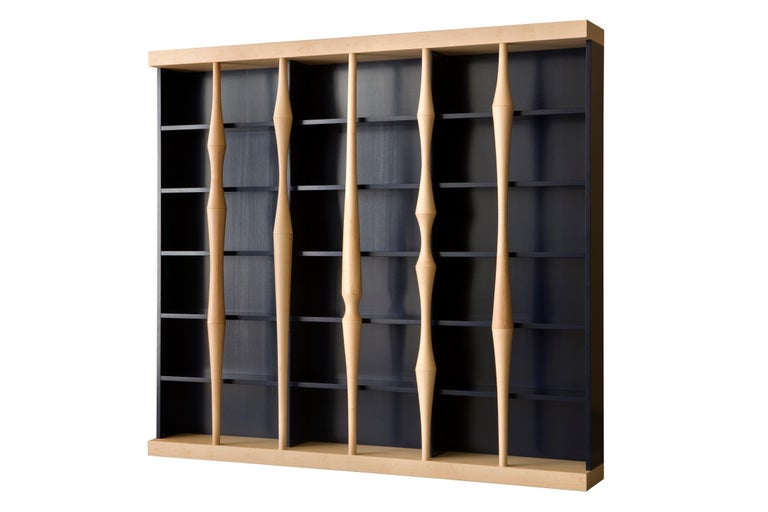 Contemporary style open bookcase, with hand turned lances made of solid maple wood Structure made of Cherry wood available in different colors. Designed by Luca Scacchetti for Morelato