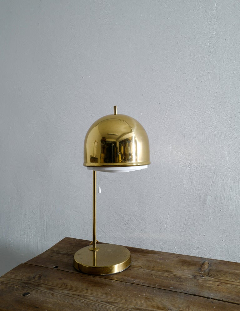 Rare table lamp in brass produced by Bergboms Sweden in the 1960s. In good original condition with some signs and patina from use.