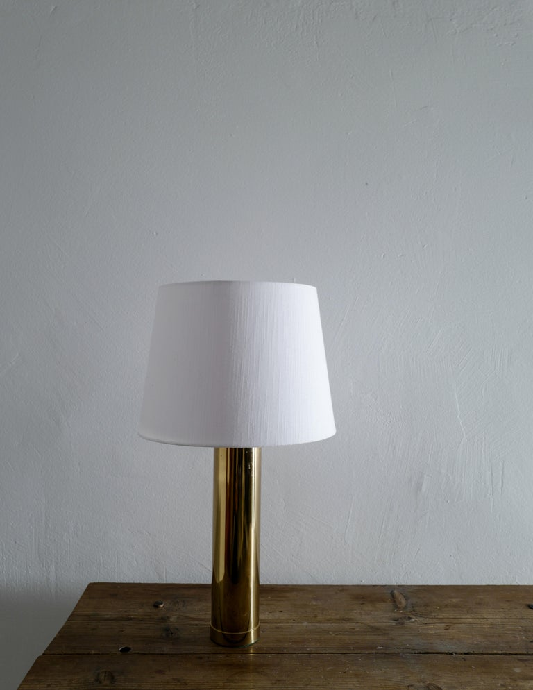Rare table lamp in brass produced by Bergboms during the 1960s. Signed and in good condition with small signs of use.  Height is measured without the shade and shade is excluded from the purchase.
