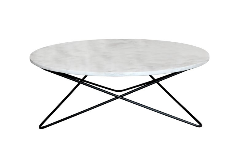 Geometric, visually kinetic cocktail table with round marble top. Can be made in any number of metal finishes, and with a wide variety of colored marble tops. Custom sizes are shapes are welcome. Can also be made as a dining or console table.