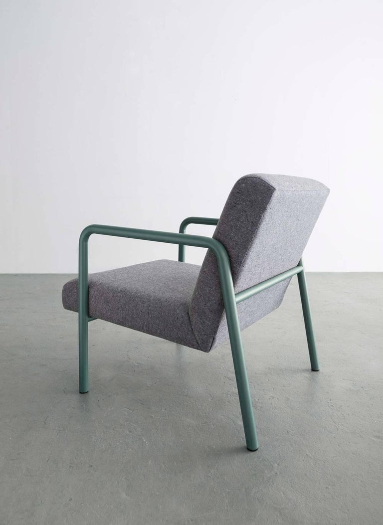 The Berm chair is leaving behind the unnecessary and making efficient forms from structural simplicity.   Powder coated frame shown in green and available in standard ral colors Grey wool upholstery also available in COM and COL.