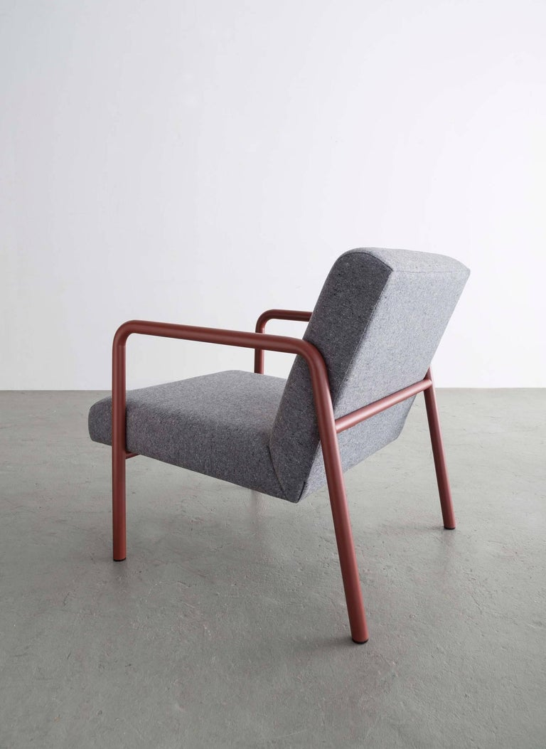 The Berm chair is leaving behind the unnecessary and making efficient forms from structural simplicity.   Powder coated frame shown in red and available in standard RAL colors Grey wool upholstery also available in COM.