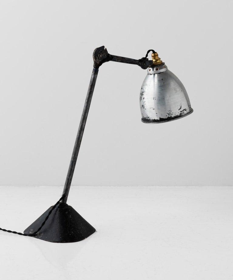 Bernard-Albin Gras Lamp No. 205, France, circa 1930.  Designed by Bernard-Albin Gras, with original black patina, iron base and unpainted metal shade.