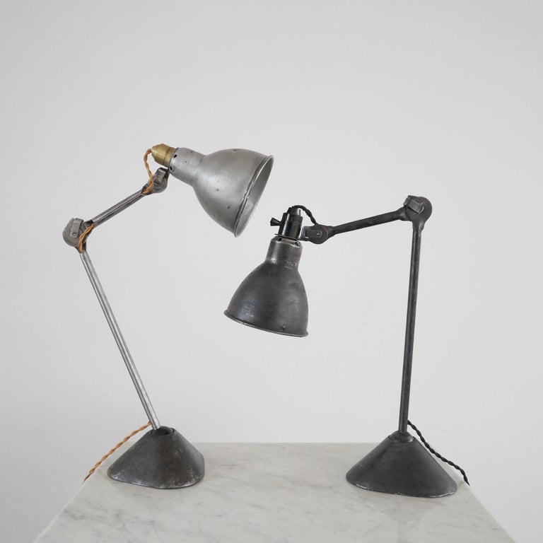 Early to mid-20th century French table lamp by Bernard-Albin Gras.  Rare model 205 with triangular base.   Adjustable in many places.  Re-wired to UK standards with black silk flex.   The middle to arms are not as stiff as they should be so