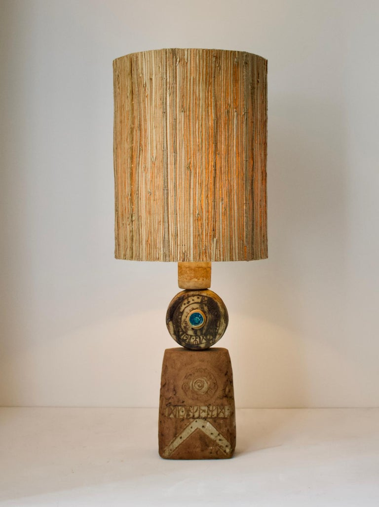 A single large, or oversize, ceramic TOTEM table lamp by Bernard Rooke, England, 1960s.  Sculptural piece, made of hand-formed ceramic elements in natural tones of terracotta, with a combination of dry and glazed finishes. The lamp is made up of