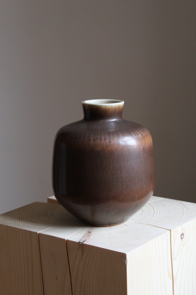 An organically shaped sizable ceramic stoneware vase by Berndt Friberg for the iconic Swedish firm Gustavsberg. Signed.  Other ceramicists of the period include Berndt Friberg, Axel Salto, Carl-Harry Stålhane and Wilhelm Kåge.