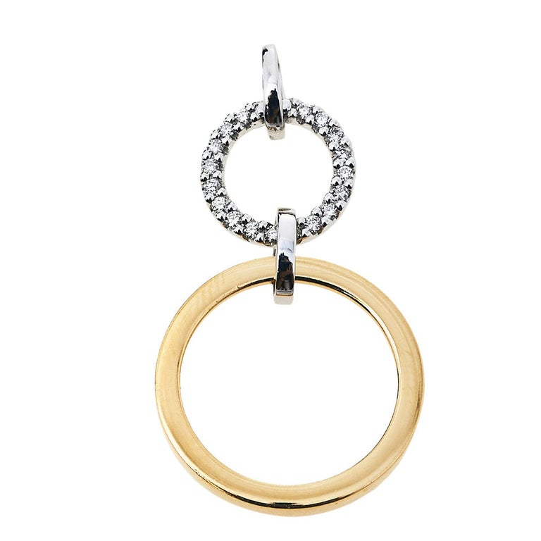 One look at this pendant by Bernhard H. Mayer and you'll know that beauty can come in small things too. Crafted from 18k gold, this pendant flaunts two differently-sized rings attached to one another. While the yellow gold ring represents the Sun,